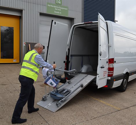 Man loading a van with equipment